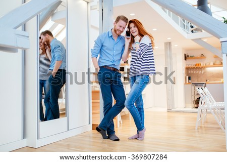 Beautiful couple in stylish home enjoying every moment - stock photo