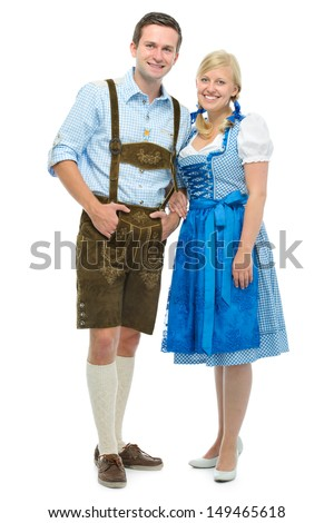 beautiful couple in traditional bavarian tracht isolated on white - stock photo