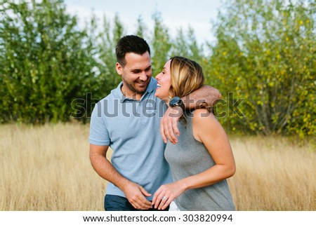Beautiful Couple in Wheat Field Laughing and Walking