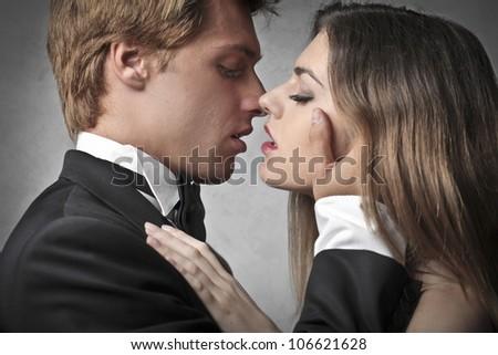 Beautiful couple kissing - stock photo