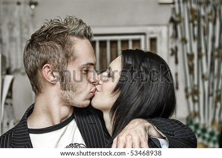 Beautiful couple kissing - stock photo