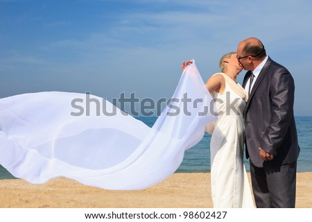 Beautiful couple kissing on the beach