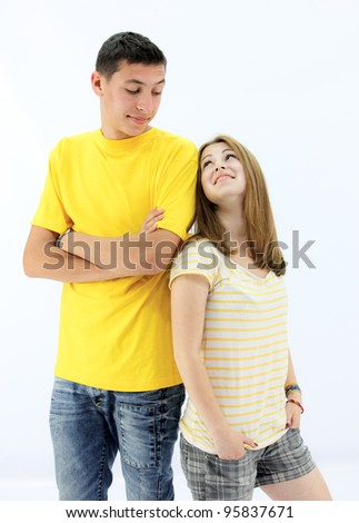 beautiful couple of teenagers in white clothes - stock photo