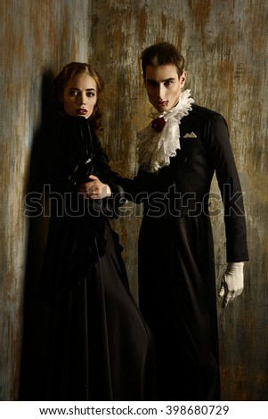 Beautiful couple of vampires dressed in medieval clothing halloween