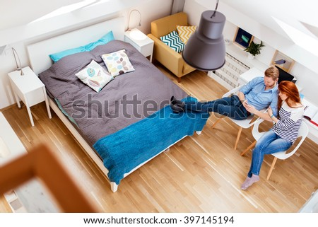 Beautiful couple relaxing at their beautiful  home viewed from above - stock photo