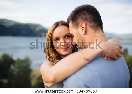 Beautiful Couple River Background girl smiling at camera