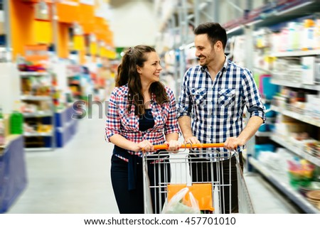 Beautiful couple shopping in supermarket