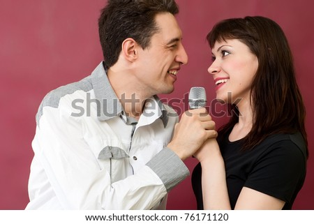 Beautiful couple sing on red burgundy background - stock photo