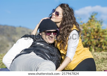 beautiful couple sitting and relaxing in the autumn mountain