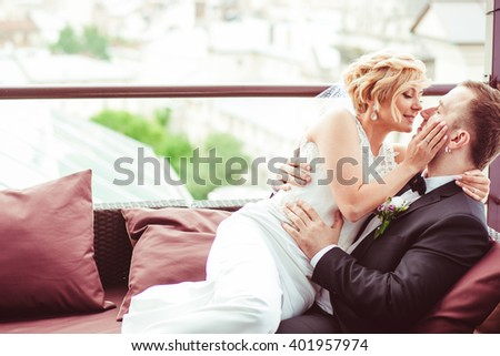 beautiful couple sitting on the couch in the room - stock photo