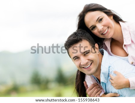 Beautiful couple smiling and looking very happy