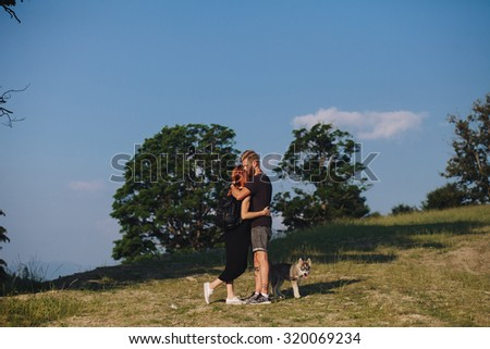 beautiful couple standing on a mountain and looking at each other