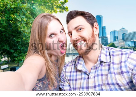 Beautiful Couple taking a selfie photo in Melbourne, Australia - stock photo