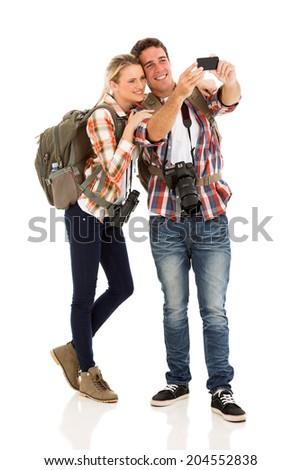 beautiful couple taking self portrait using smart phone - stock photo