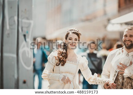 Beautiful couple walking together in the city center