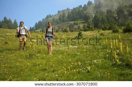 Beautiful couple with backpacks traveling in Visitor Mountains, Montenegro