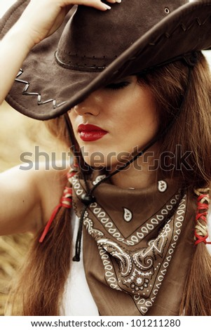 Beautiful cowgirl. Shot in the stable - stock photo
