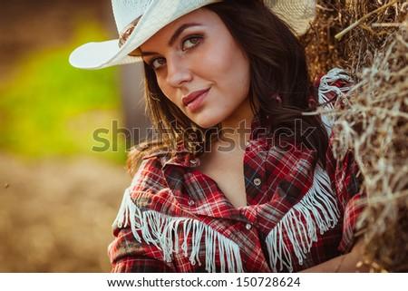beautiful cowgirl style closeup model model on farmland - stock photo