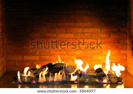 beautiful cozy fireplace lit by the fire - stock photo