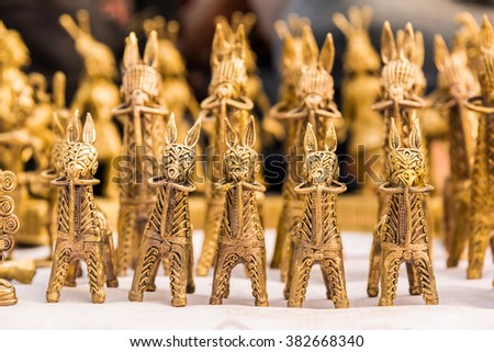 Beautiful crafted miniature horses made of brass arranged for sale - stock photo