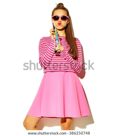 beautiful crazy smiling brunette woman girl in casual hipster summer colorful clothes with red lips isolated on white drinking soda from bottle with straw in sunglasses  - stock photo