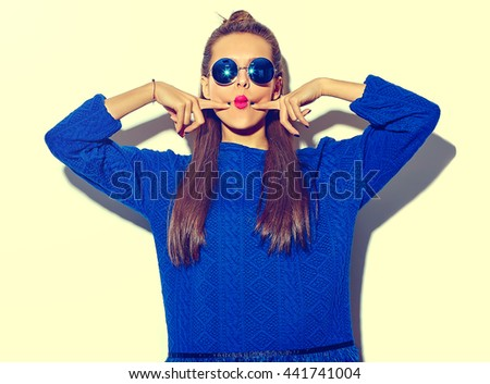 "beautiful crazy smiling brunette woman girl in casual hipster summer colorful clothes with red lips isolated on white  in sunglasses making funny ""fish-face"" - stock photo"