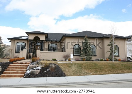 Beautiful cream colored stucco house - stock photo