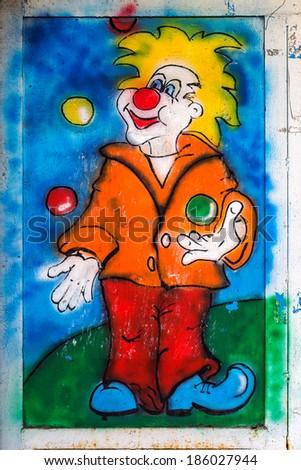 beautiful creative graffiti and circus clowns, artistic decoration of the old walls of city streets as an abstract creative background