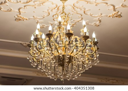 beautiful crystal chandelier in a room - stock photo