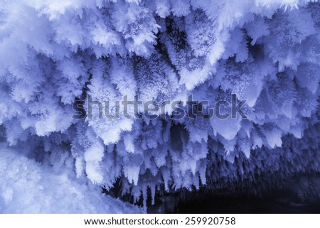 Beautiful crystal ice structures form inside the Lake Superior sea caves in Northern Wisconsin - stock photo