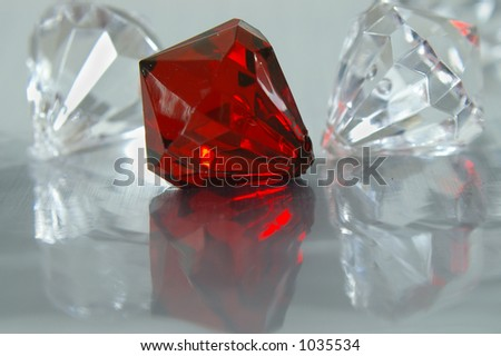 Beautiful crystals reflected over a metallic backdrop. - stock photo