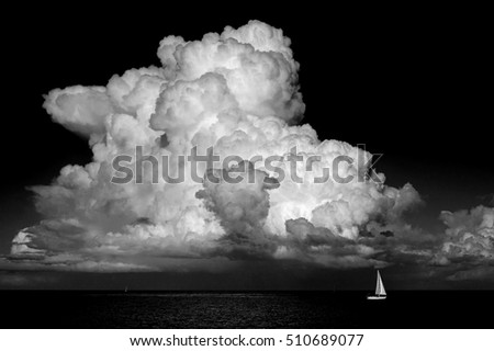 beautiful cumulus cloud over ocean weather and travel background, monochrome