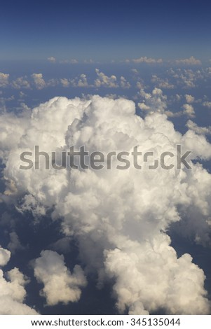 Beautiful cumulus clouds in the sky above the earth. - stock photo