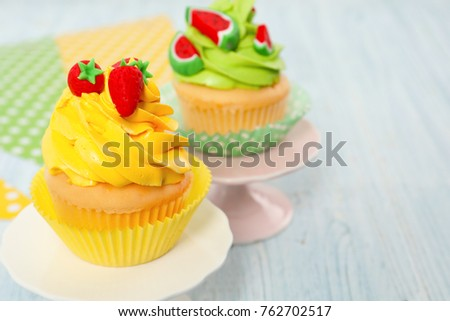 Beautiful cupcakes on wooden table
