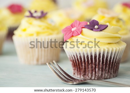 Beautiful cupcakes with yellow frosting - stock photo