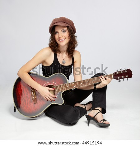 beautiful curly girl with acoustic guitar