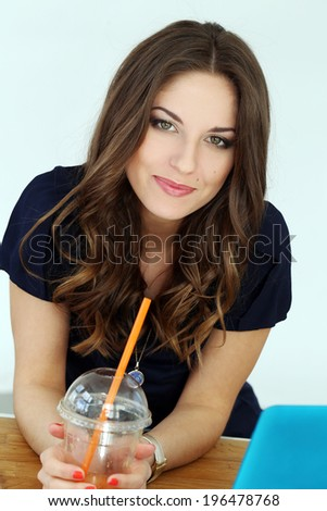 Beautiful, curly woman with laptop - stock photo