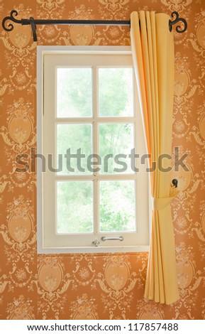 beautiful curtain on edge of a white window - stock photo