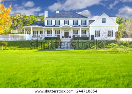 Beautiful Custom Built Home Facade and Yard. - stock photo
