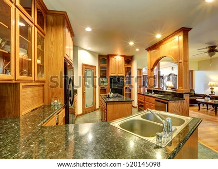 Beautiful custom designed kitchen room with gorgeous granite counter tops, kitchen island, pantry and glass-front cabinets. Northwest, USA