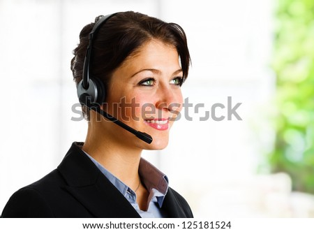 Beautiful customer representative at work - stock photo