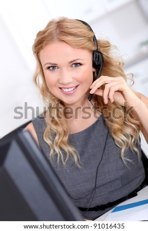 Beautiful customer-service woman with headset on - stock photo