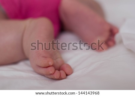 Beautiful Cute Baby Asian Girl's feet - stock photo