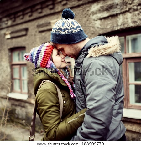 Beautiful cute couple vleblennaya fall in the house - stock photo
