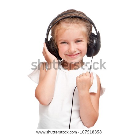 Beautiful cute happy little girl with headphones - stock photo