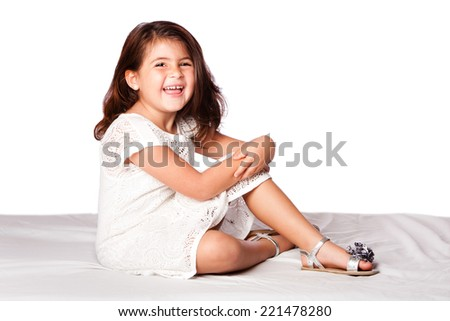 beautiful cute happy smiling girl sitting, on white. - stock photo