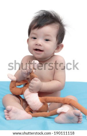 Beautiful Cute little baby girl of asian with toy