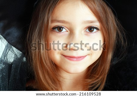 beautiful cute little girl in witch halloween costume close up face - stock photo