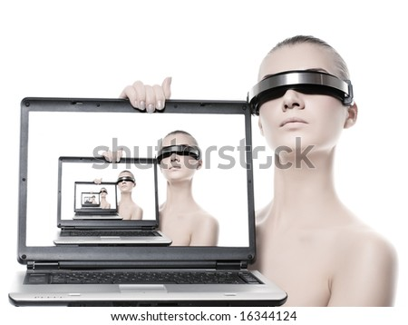Beautiful cyber woman with a laptop computer. Isolated on white background - stock photo