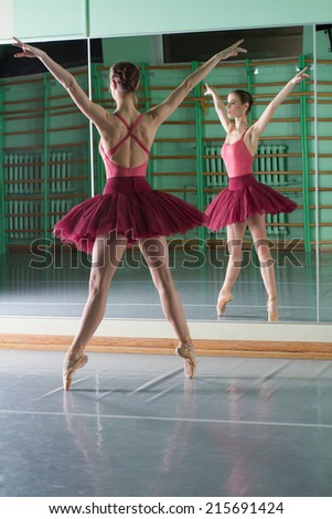 Beautiful dancer ballerina with reflection - stock photo